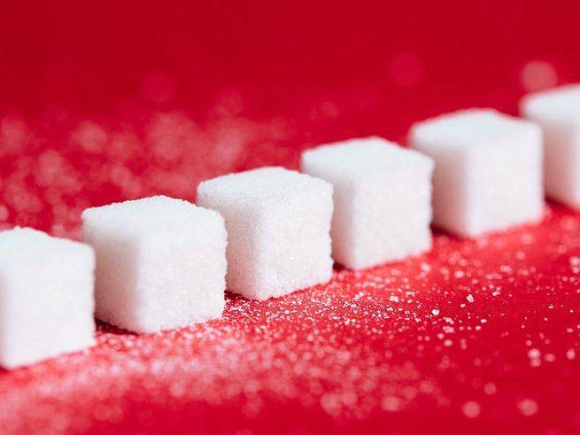 sugar cubes red background